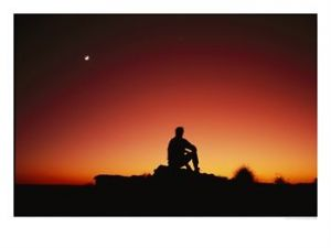 131854silhouette-of-sitting-man-looking-at-the-sunset-and-the-moon-posters